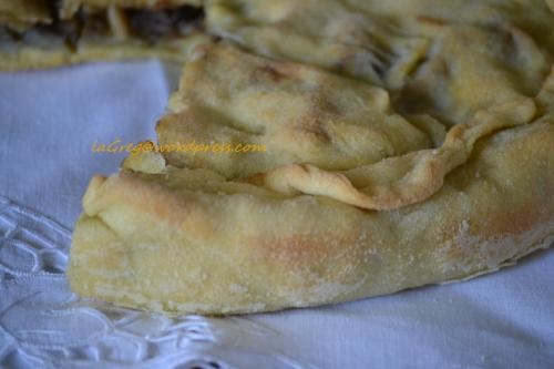 rustico di semola ripieno di melanzane, patate e alici
